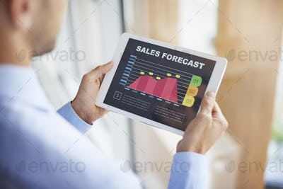 Sales forecast on digital tablet