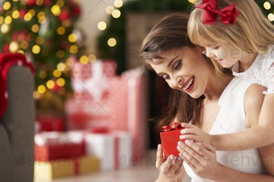 Litte girl suprises mummy by giving present