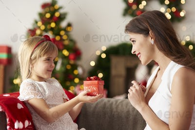 Daughter handing over gift for mummy