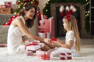 Exchanging presents between woman and girl