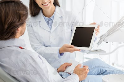Close up of blank digital tablet screen holding by dentist