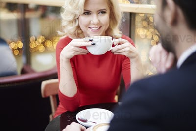 Woman sitting face to face with partner in the cafe