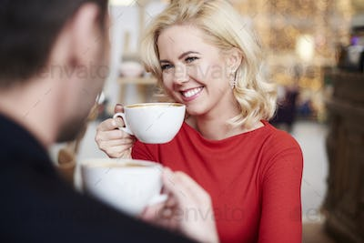 Shot of woman holding cup of coffee on a date