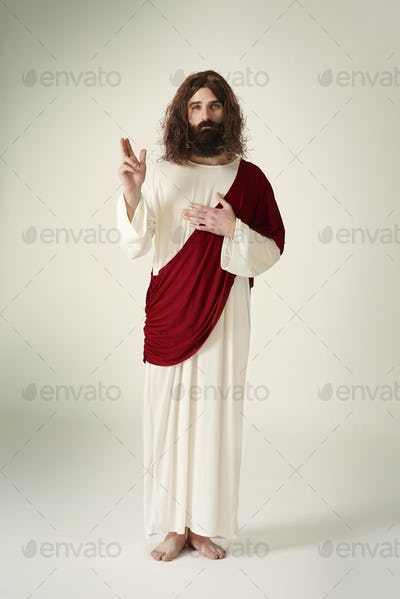 Jesus showing the symbol of peace