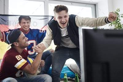 Friends watching exciting sports game