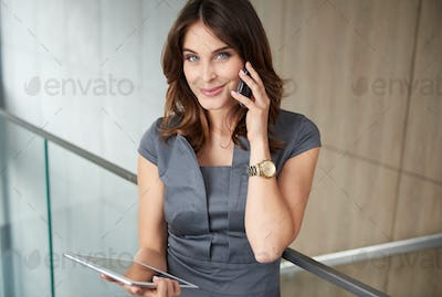 Modern woman with phone and digital tablet