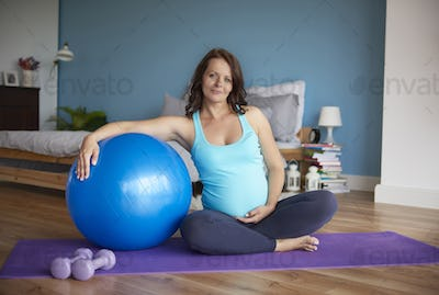 Pregnant woman start session of yoga