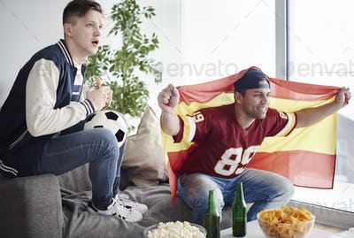 Male fans soccer fan watching game