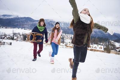 Family having winter activities outdoors