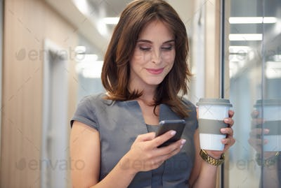 Drinking coffee and operating the phone