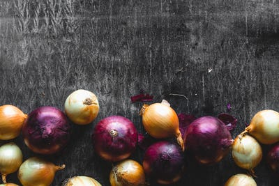 onions on black wood table background