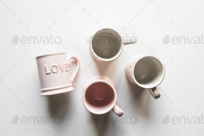 pink cups with love, white background. concept of romantic meeting, love, romantic breakfast