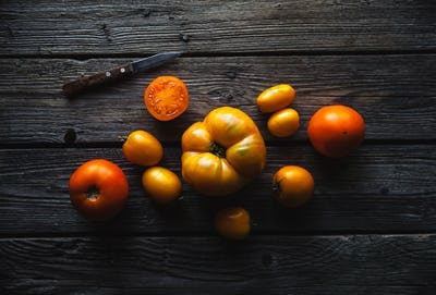 Ripe red tomatoes on a wooden background, healthy food, vegetables