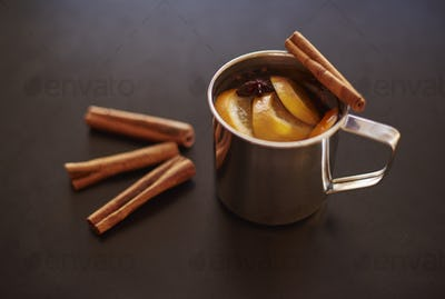 Cup of mulled wine with cinnamon stick