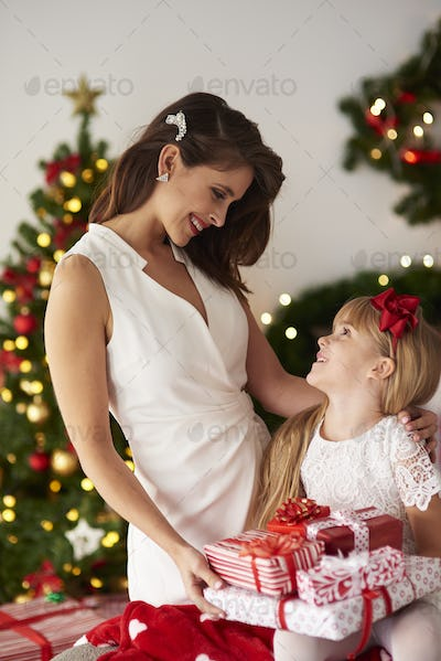 Mother sharing with daughter presents