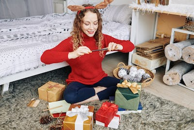 Charming woman taking photos of gifts