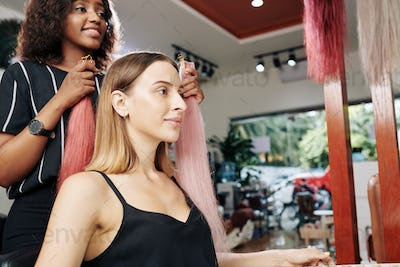 Hairstylist choosing best colorful extensions