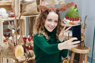 Woman taking photos among decorations