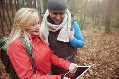 Mature couple and digital tablet