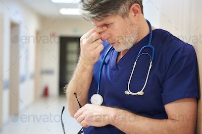 Mature doctor tired after long day