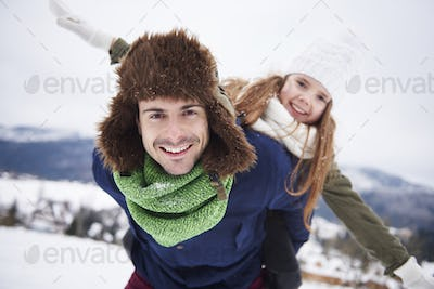 Father and dauther having fun outside