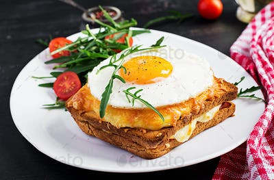 Breakfast. French cuisine. Croque madame sandwich close up on th