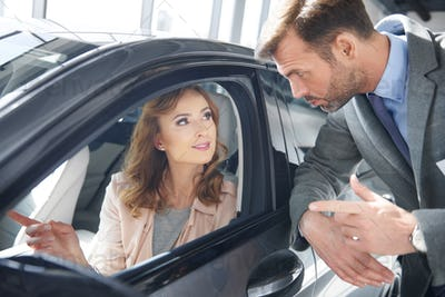 Salesman giving an advice to female customer