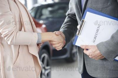 Close up of handshake customer and salesman
