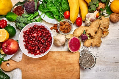 Selection of rich in antioxidants and vitamins and mineral around cutting board.