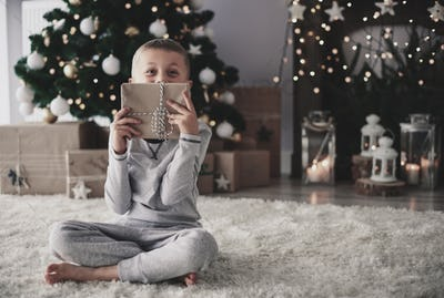 Boy posing with a  christmas present