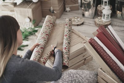 Rear view of woman cutting a christmas paper