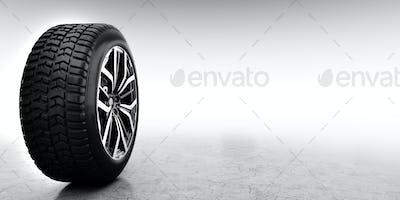 Wheel with modern alu rim on white background