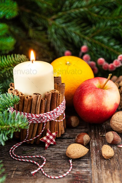 Burning candle and rustic decorations
