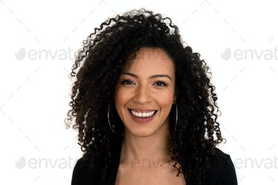 Isolated portrait of a latin woman with curly hair