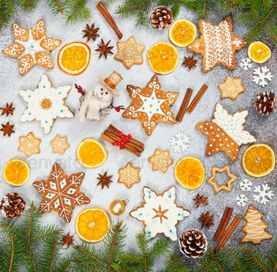 Christmas ginger cookies in the shape snowflakes, dried orange, star anise and snowman