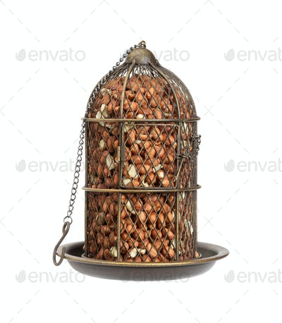 Bunker type bird feeder in vintage style with raw peanats