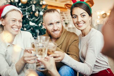 Young People Toasting at Christmas Party