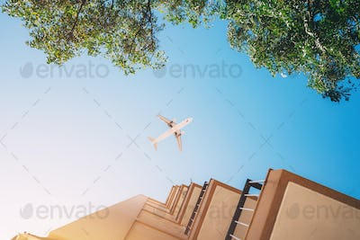 Airplane Flying Over the Blue Sky.
