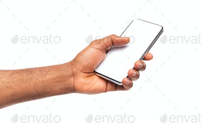 Black man's hand demonstrating modern smartphone with blank screen