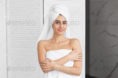 Girl Wrapped In Towel Standing Smiling At Camera In Bathroom