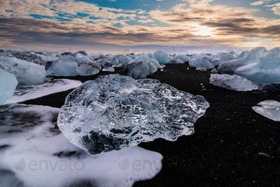 Ice rock with black sand beach at Jokulsarlon beach. Diamond beach in Iceland