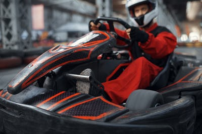Kart racer enters the turn, karting auto sport