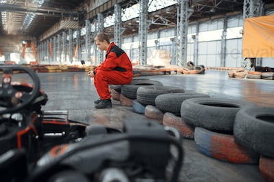 Go kart racer sitting on tires, karting auto sport