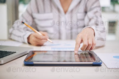 Woman using tablet while working