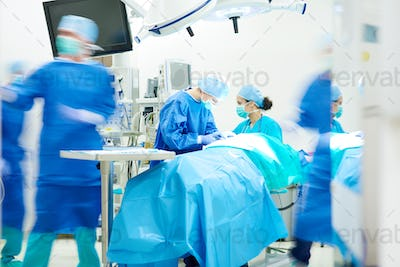 Surgeon team working together while operation