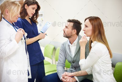 Medical team explaining results to patients relatives