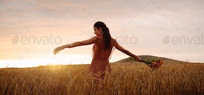 Happy woman enjoying in wheat field