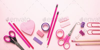 Flat lay of office, school stationery on pink background
