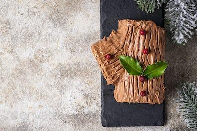 Christmas yule log cake. Traditional chocolate dessert
