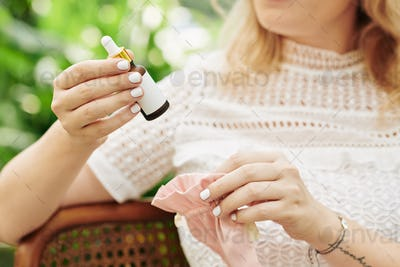 Woman taking essential oil